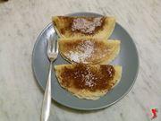 crepes farcite con nutella, miele, marmellata e spolverata di cacao e zucchero a velo