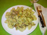 La pasta con funghi e salsicce