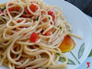spaghetti con pomodorini e colatura di alici