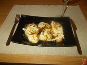 Le patate al forno con la cipolla